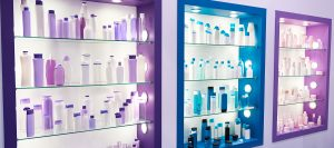 Picture of showcase with bottles of shampoos and conditioners